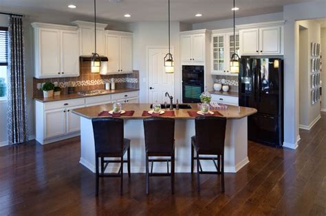featuring  cashmere recessed panel maple cabinets