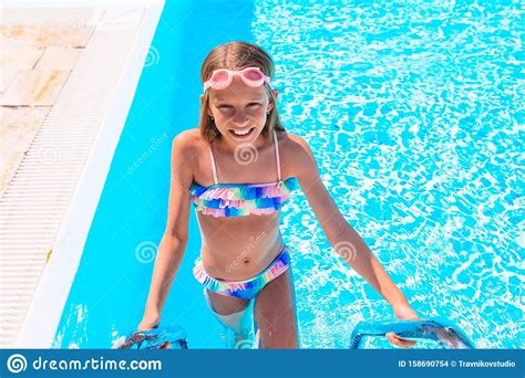 adorable  girl swimming  outdoor swimming pool