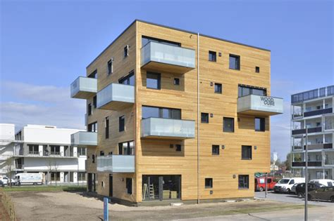 Compact House Made From Affordable Materials by Woodcube Carbon Neutral Five Story Wooden Apartment