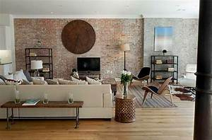 Adding an exposed brick wall to your home for Brick wall living room design