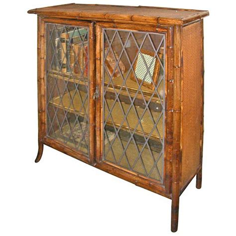 Bamboo And Rattan Bookcase With Glass Trellised Doors At