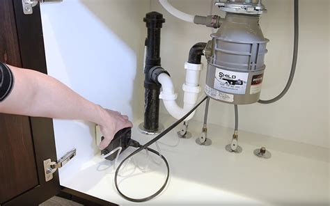 install electrical outlet under sink fixing a jammed garbage disposal