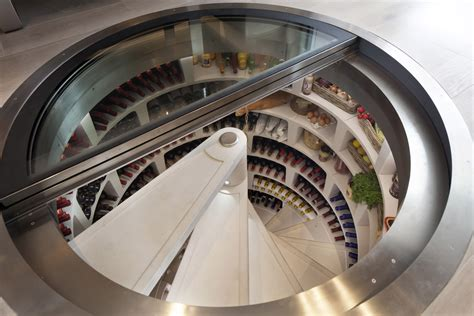 spiral wine cellar in kitchen floor spiral cellars available via genuwine cellars in america 9374
