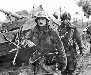 """Soldiers of the """"Hermann Goering"""" division walk past a ..."""