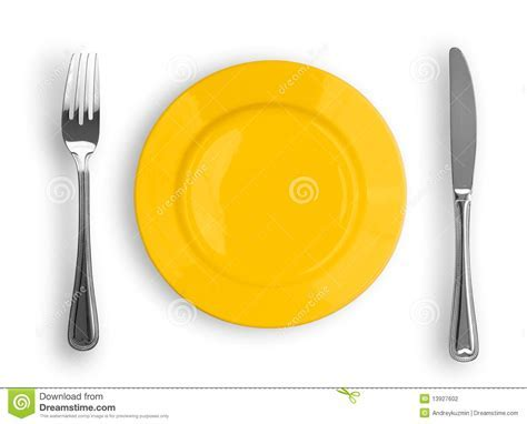 Knife, Yellow Plate And Fork Isolated Top View Stock