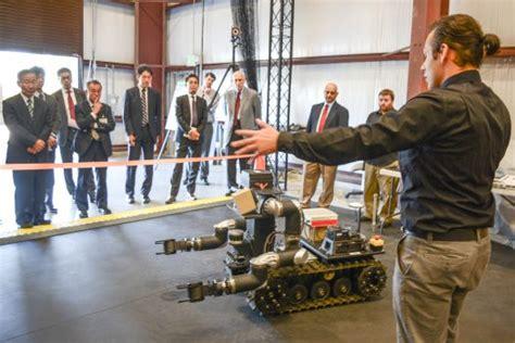 japanese defense industry delegation visits army lab