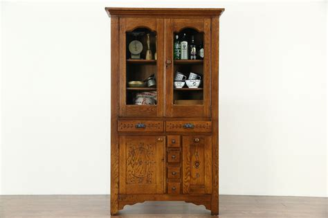 sold victorian eastlake  antique oak pantry cabinet