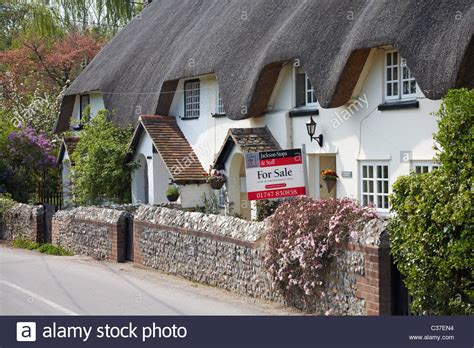 Row Of Thatched Cottages With One For Sale At Tarrant