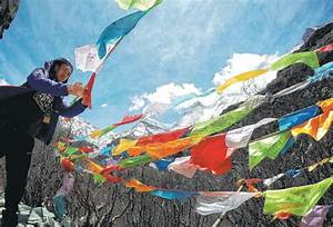 A Visitor Takes A Picture At The Yading Scenic Spot Which