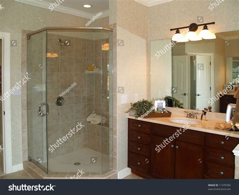 Luxurious Marble Bathroom With Glass Enclosed Shower And