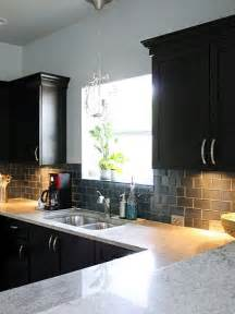 black backsplash in kitchen glass backsplash and black cabinets kitchens