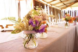 wedding reception centerpieces country rustic wedding reception floral centerpieces onewed