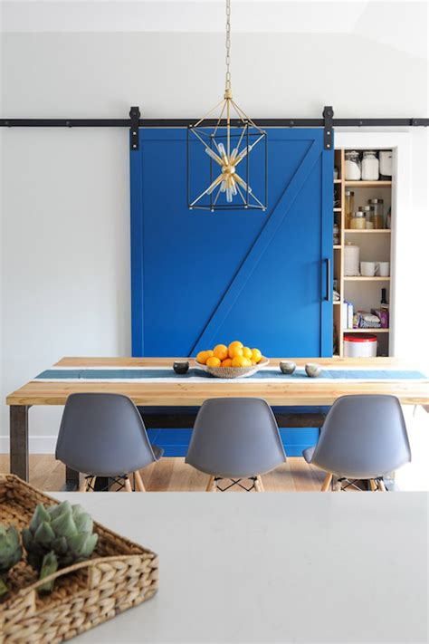 wood dining room sets pantry with blue barn door transitional dining room