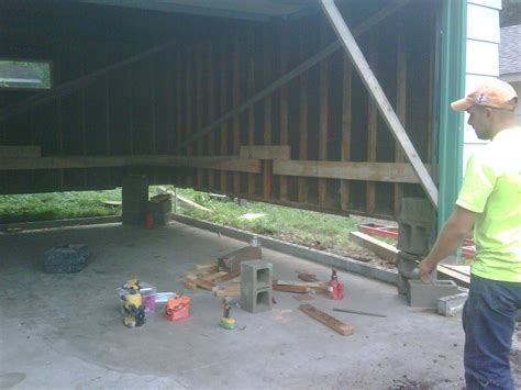lifting a garage from the foundation garage floors replacement goodmanson construction