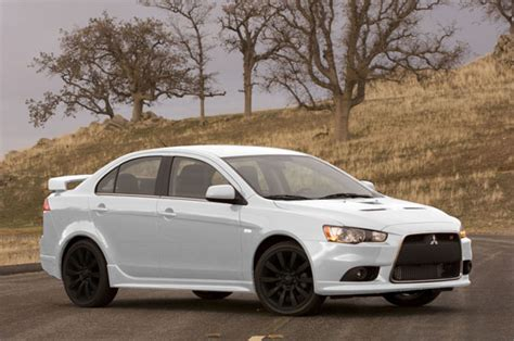 white mitsubishi lancer with black rims paint rims black gunmetal gold or stock page 2