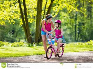 Mother Teaching Child To Ride A Bike Stock Photo - Image ...