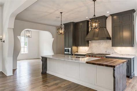 gray kitchen cabinets  white island mediterranean