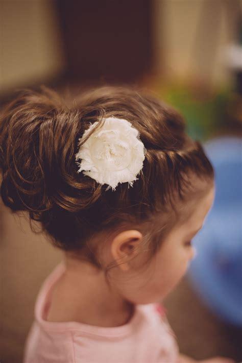 flower girl hair updo braided twist into an upside down
