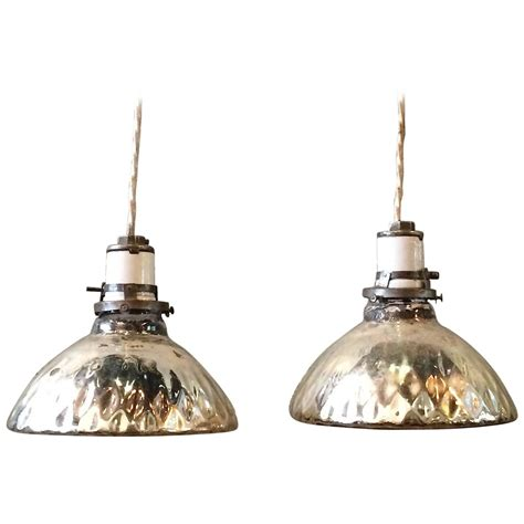 pair of petite silver quilted mercury glass pendant lights