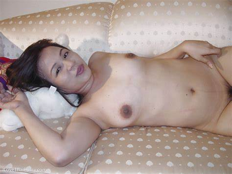 Asian Babe Takes Off Her Clothes In The At Home