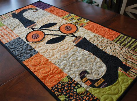 halloween quilted table runner last one halloween blooming boots table runner quilt kit