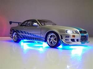 Nissan Skyline Fast And Furious : 2 fast 2 furious paul walker 1 18 nissan skyline brian 39 s gt r r34 led lights ebay ~ Medecine-chirurgie-esthetiques.com Avis de Voitures