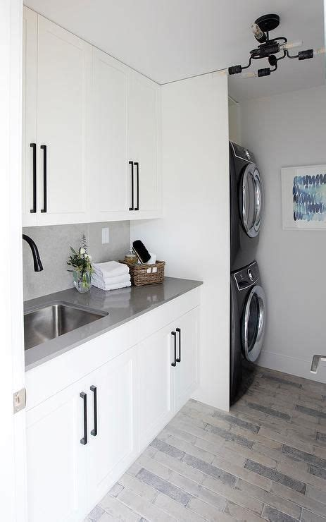 gray  black floor tiles accent white shaker cabinets