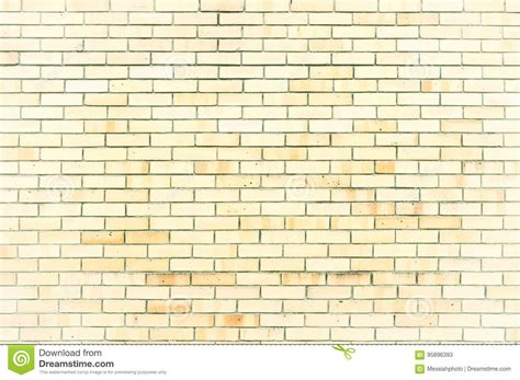 texture background of light yellow brick wall
