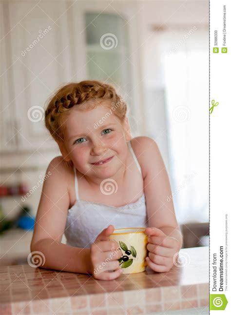 girl  cup  tea   kitchen stock photo image