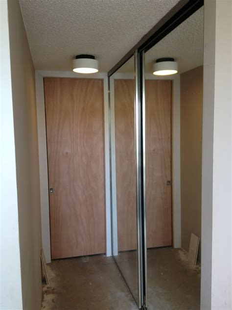pocket door new closet shelving and sliding mirrored