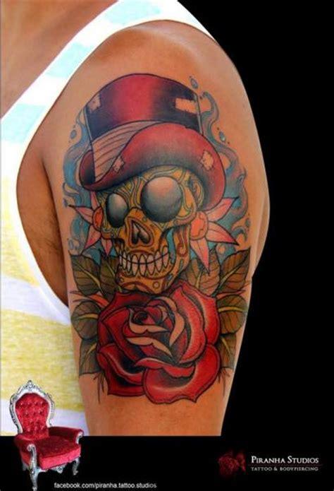 school flower skull hat tattoo  piranha tattoo studio