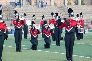 Several LHS marching band members take the knee during ...