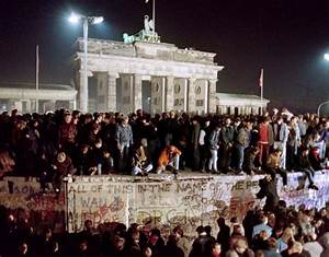 Thousands of young East Berliners crowd atop the Berlin ...