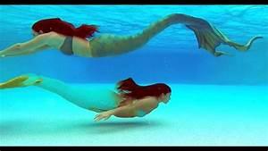 Mermaids Swimming Underwater