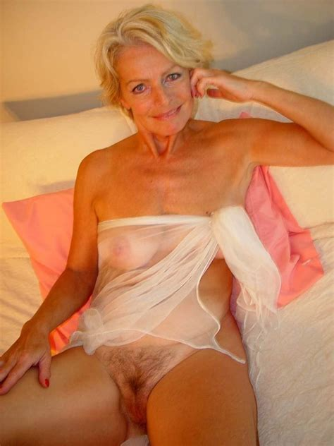 Hot Blonde Mature Justine Posing Naked On The Bed