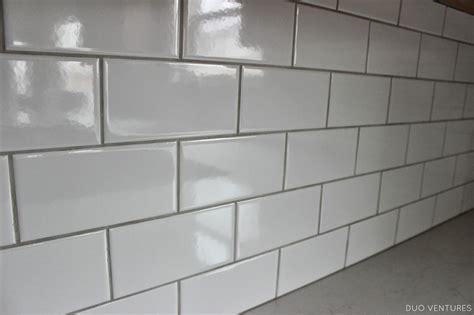 kitchen update grouting caulking subway tile backsplash
