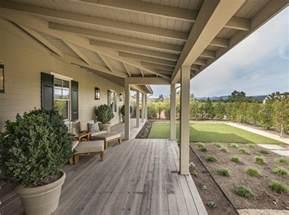 wrap around porch ideas napa valley farmhouse with neutral interiors interior