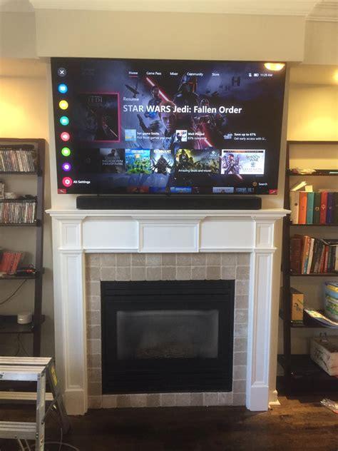 above fireplace tv installation