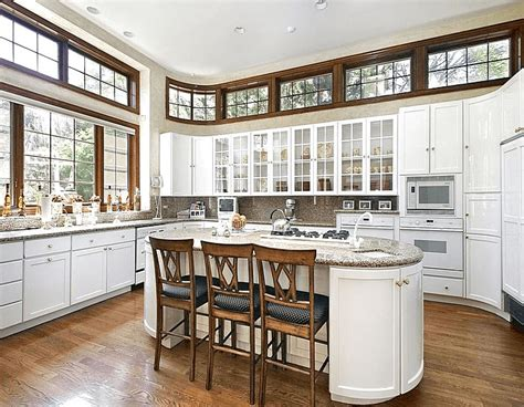 Kitchen Island With Stove Top, Seating, Sink, And Oven Ranges
