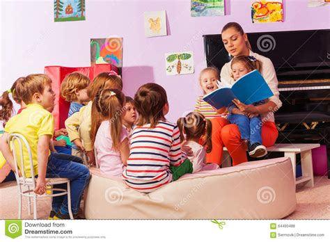 Nurse In Kindergarten Read Book To The Class Stock Photo  Image Of Child, Books 64493488