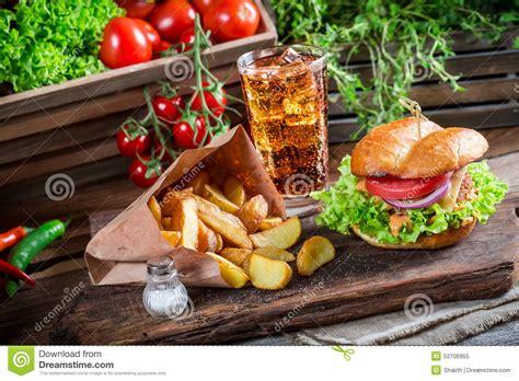 tasty chicken burger  cold drink  fries stock photo