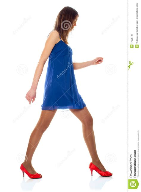 Young Woman With Blue Dress And Red Shoes Royalty Free Stock Photography - Image 17598747