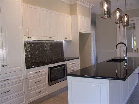 pictures of kitchen with white cabinets this kitchen features jet black granite benchtops with 9114