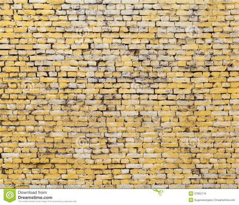 old yellow old yellow brick wall background texture stock image