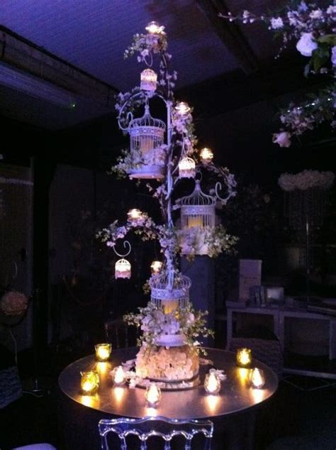 birdcage centrepiece triple birdcage stand with hanging candle votives essentialweddinghire com a fairytale