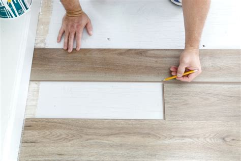 how to cut vinyl plank flooring how to install luxury vinyl plank flooring sand and sisal