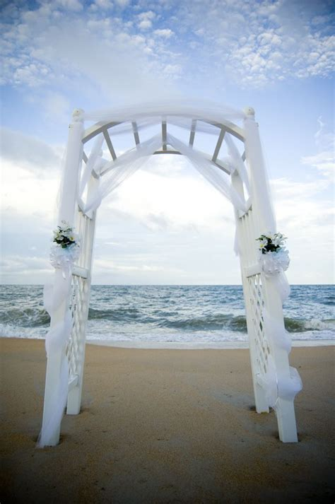 A Sweet And Simple White Tulle Arch With Greens Speaks