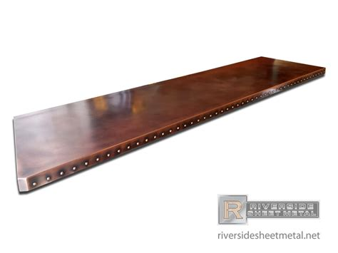 custom copper bar table top with dark wash patina and rivets