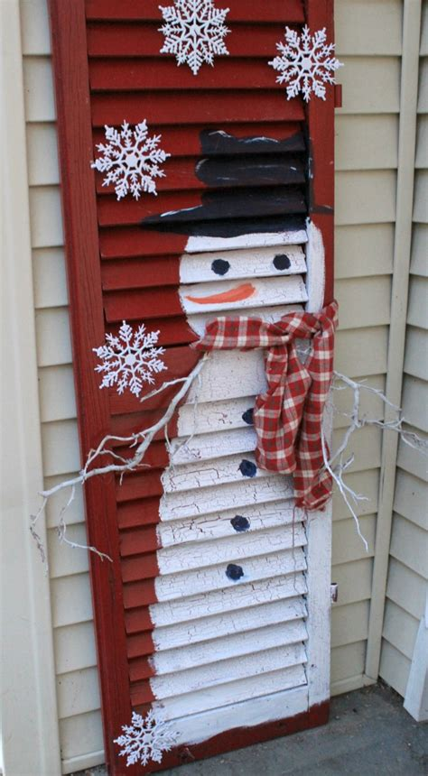 diy snowman and santa from cedar fence posts crafts a la mode