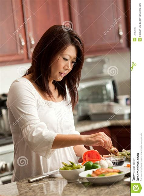 asian woman preparing food  kitchen stock photo image